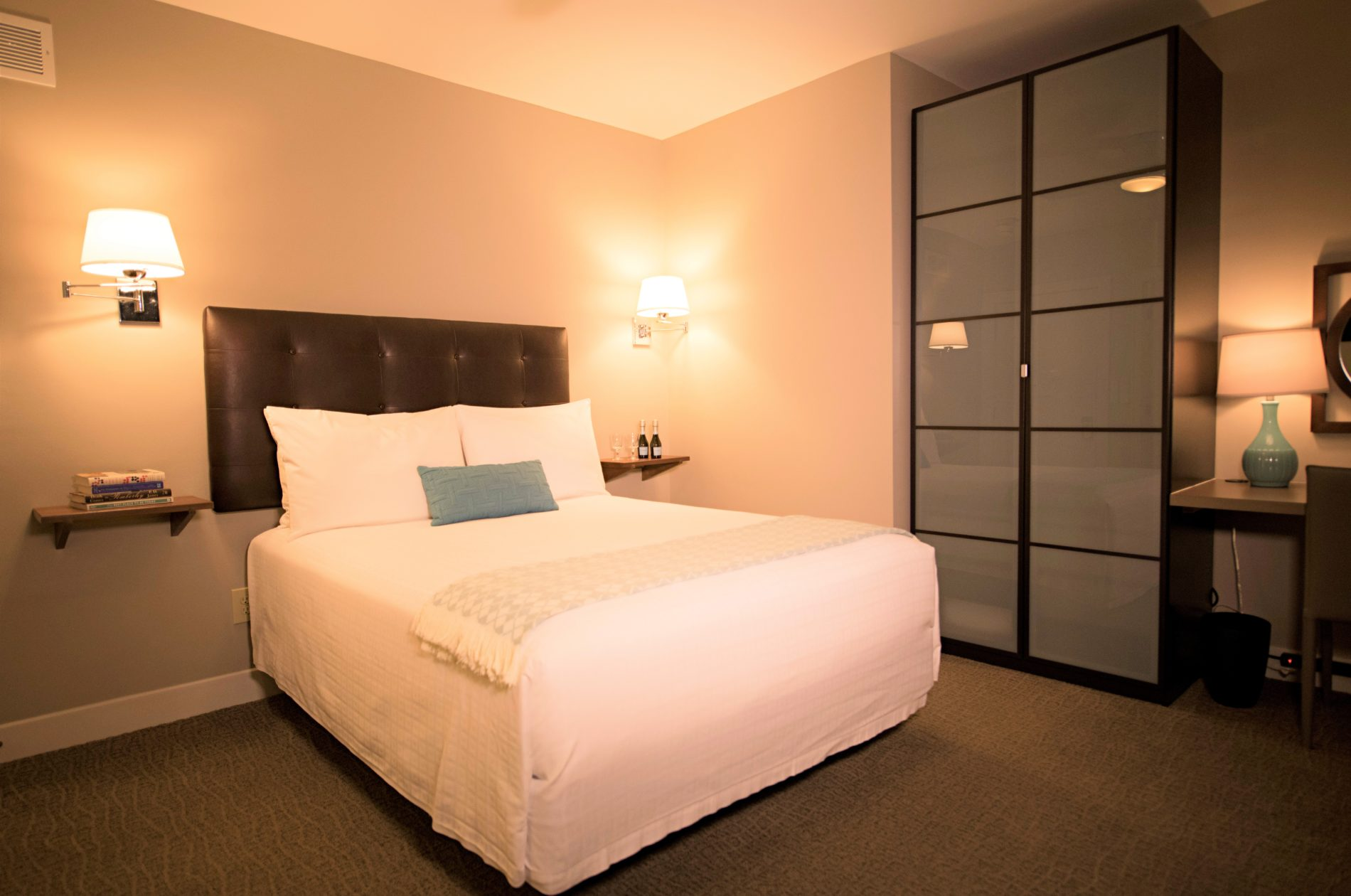 Room One with view of bed and armoire