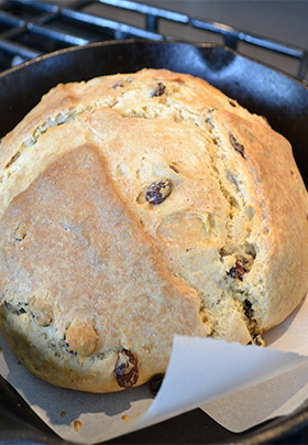 fresh from the oven golden-crusted Irish Soda Bread baked in a cast iron skillet