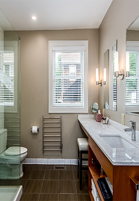 Interior of Room Two bathroom showing extended vanity with quartz counter and white linens